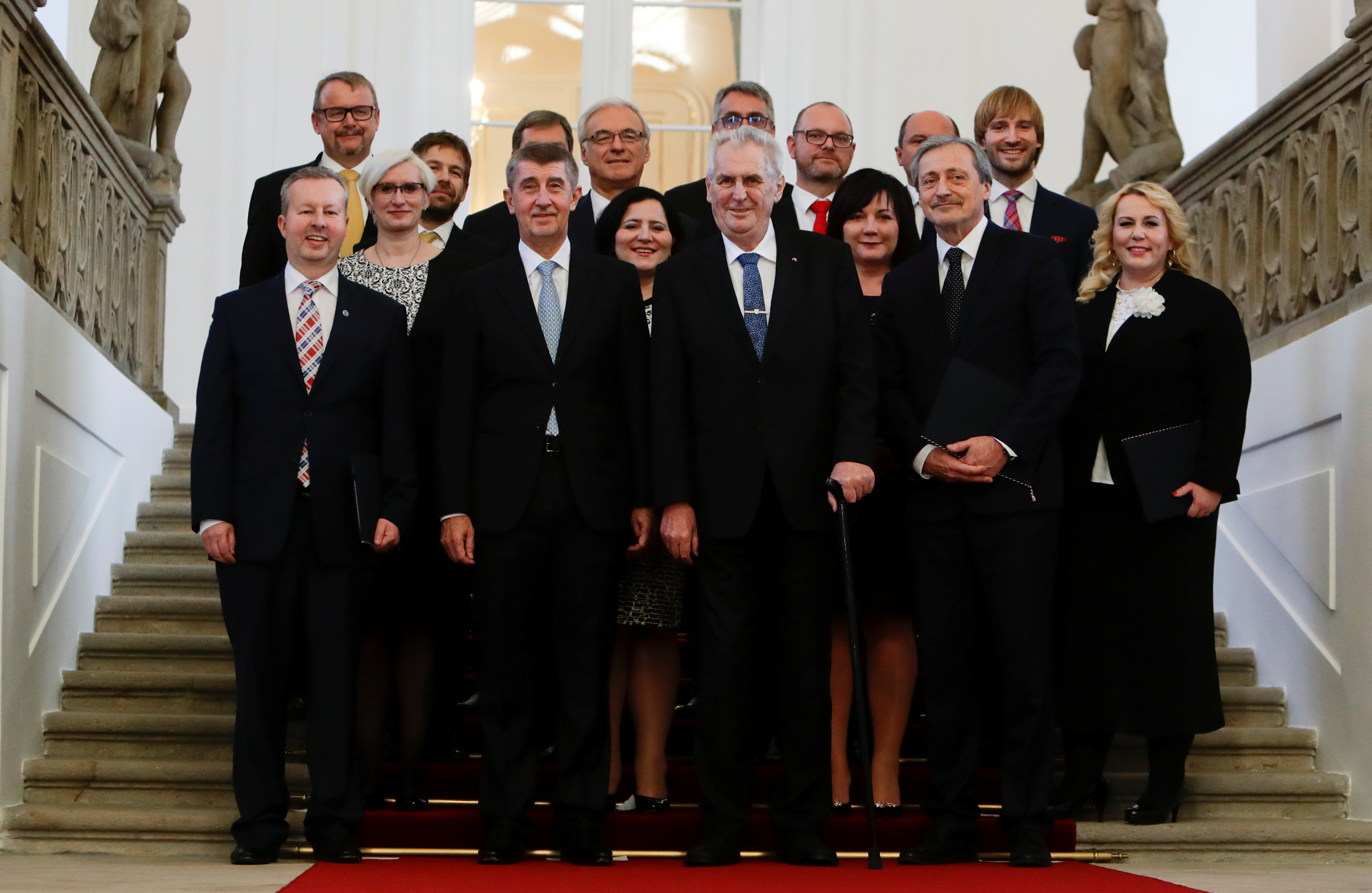 Prime Minister Andrej Babis and Czech President Milos Zeman pose for a group photograph with newly appointed members of the Czech government during the cabinet's inauguration at Prague Castle in Prague, Czech Republic December 13, 2017. REUTERS/David W Cerny